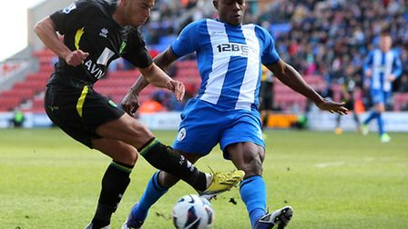 Elliott Bennett sees his cross blocked as Norwich City drew a blank at the DW Stadium. Picture by Pa