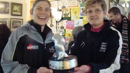 Magpies' captain Charlotte Harrison receives the Investec National League East Conference trophy fro
