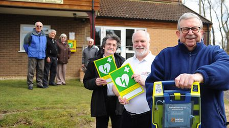 MP Keith Simpson, front right, with the newly fitted defibrillator at Cawston Village Hall. With him