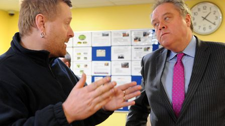 Euro MP Richard Howitt listens to Paul Smith as he explains how the bedroom tax will affect his fami
