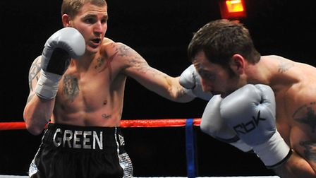 Norwich's Duane Green (left) had a debut win over Drew Campbell, of Colchester.