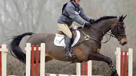 Norfolk's Piggy French in action on Bornio in the Great Witchingham International horse trials at Bl