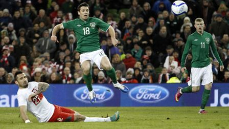 Wes Hoolahan scores for the Republic of Ireland against Poland in February.