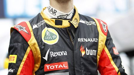 Romain Grosjean hold shis head up high ahead of the opening race of the 2013 Formula One season in A