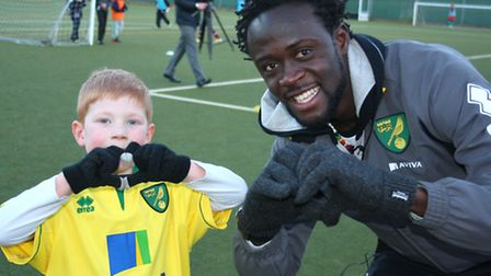 Evan Simpson practises his heart-shaped hands goal celebration with Kei Kamara during his visit to C