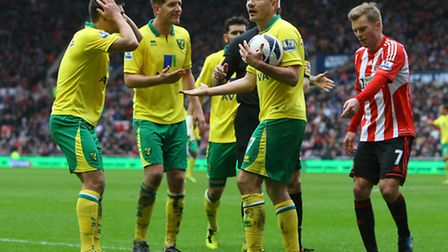 The Norwich City players claim to referee Chris Foy that the handball by Sunderland's Danny Rose was