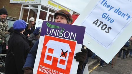 Opponents make their feelings known during a protest outside MP Simon Wright's office in Norwich ove
