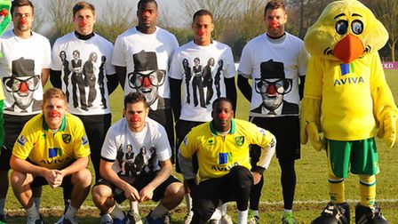Norwich City football players wearing t shirts and red noses for Comic Relief's red nose day, with m