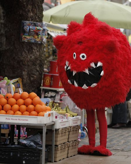 Dinomite takes in the sights on a visit to Norwich ahead of this year's Red Nose Day.