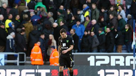 A dejected Robert Snodgrass leaves the field after Norwich City's defeat at Wigan. Picture: Paul Che