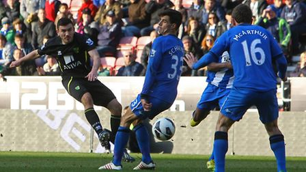 Norwich City winger Robert Snodgrass gets a shot off at the DW Stadium. Picture by Paul Chesterton/F