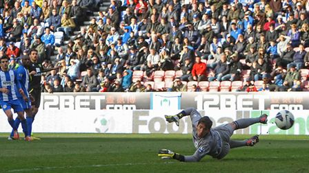 Wigan goalkeeper Joel Robles watches a shot by Bradley Johnson go wide. Picture: Paul Chesterton / F