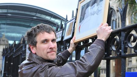 Simon Warner, the only artist to hang his work on the railings of St Peter Mancroft on Saturday.Phot