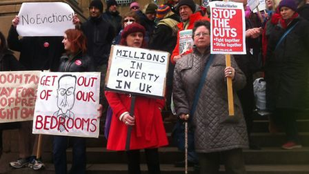 Campaigners protest on the steps of City Hall about welfare reforms they say will hit the vulnerable