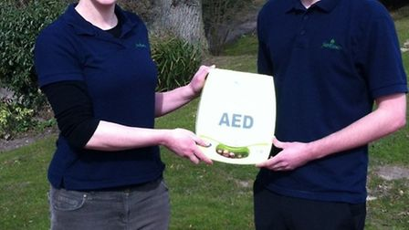 Michael Cooper and Louise Rout with defibrillator