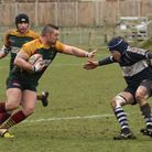 Joe Riches hands off a Sudbury opponent during Saturday's London 3NE fixture.