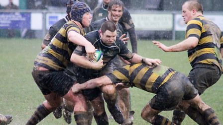 Mark McCall ploughs through the Scottow mud during the 33-0 victory over Braintree that took North W
