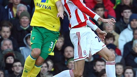 Steven Whittaker and Peter Crouch battle for the ball the last time Norwich City faced Stoke. Pictur