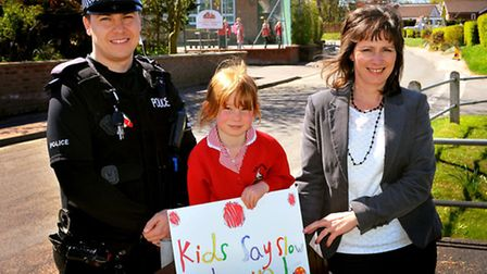 Five-year-old Violet Wadham gets the road safety message across outside Surlingham school with help