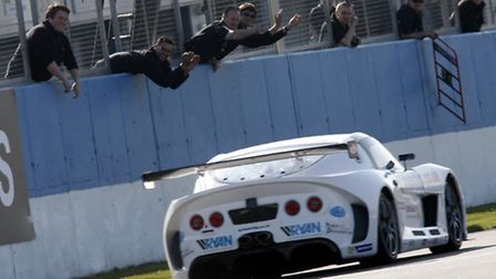 Carl Breeze is cheered in by his team after winning at Donnington Park in the Ginetta GT Supercup.