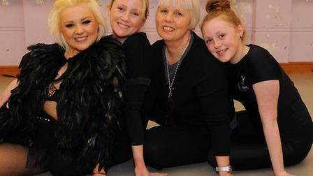 Heather Millan, 2nd right, and her daughter, Sarah, 2nd left, who run the Heather Millan School of D