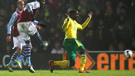 Christian Benteke scores against Norwich City in the Capital One Cup.