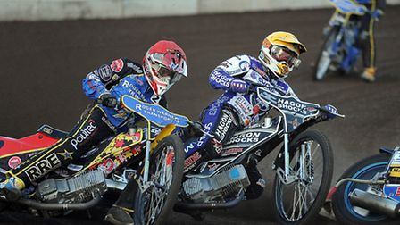 Action from King's Lynn Stars v Swindon at the Norfolk Arena - Heat 3 and David Howe battles for the