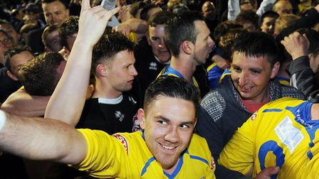 Action from King's Lynn Town v Sheffield at The Walks - Lynn fans invade the pitch and celebrate wit