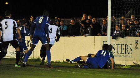 Chris Henderson (hidden) scores the only goal of the game as Lowestoft Town dig in to win their Ryma