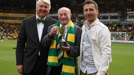 Clifford Dann receiving his fan of the year award in 2012 in the middle with NCFC Chairman Alan Bowk
