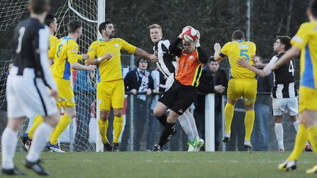 Lynn's keeper Danny Gay collects the ball during Tuesday's trip to Coalville. Picture: Ian Burt