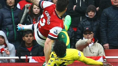 Norwich's Kei Kamara conceded a penalty against Arsenal after being adjudged to have manhandled Gunn