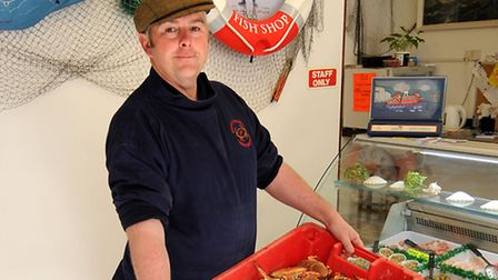 Cromer fisherman, John Davies, pictured at his shop with one of the first crab hauls of the season.P