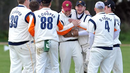 Diss players celebrate a wicket against Ashmanhaugh & Barton Wanderers.