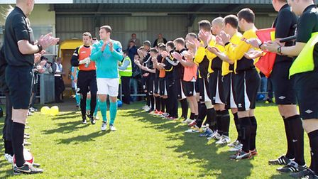 King's Lynn Town players recieve a guard of honour at Belper Town. Picture: Tim Harrison.