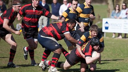 Josh Mickleburgh powers above the line for Wymondham against Southwold on Saturday.