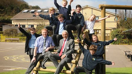 Cromer Junior School celebrate their outstanding Ofsted report. Right, headteacher Steve Godson and