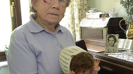 Olive Fabb with one of April's dolls, pictured in 2002.