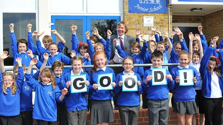 Children at Drayton junior school celebrate the Ofsted result with head teacher Martin White.Photo: