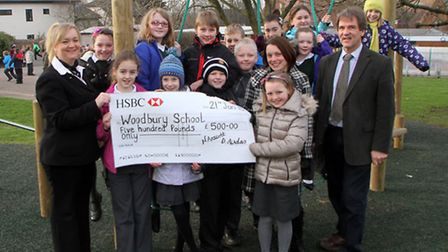 Woodbury Primary School received a cheque from HSBC bank for £500 to go towards the school's adventu
