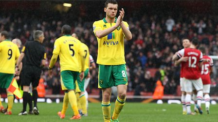 Jonny Howson applauds the Norwich City fans after their late defeat at Arsenal last month. Picture: