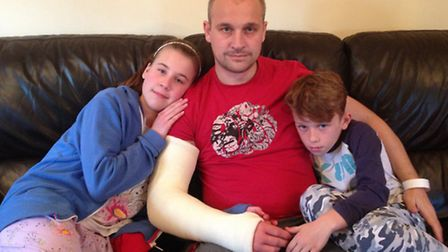Dersingham Rovers joint manager Robbie Back at home with his children Harvey and Emily.