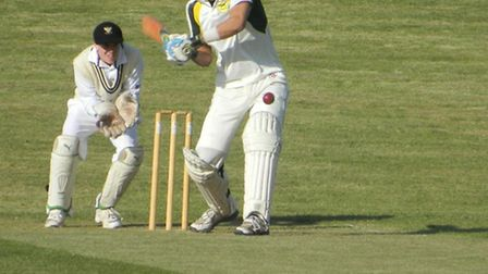 Cricket - Budleigh in pre-season at Bradninch James Burke hits another boundary