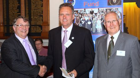 The attached photograph shows Dream-A-Way Chairman Jeff Merrett MBE receiving the cheque from R.W. B