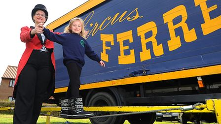 Pupils at Clover Hill Infant School in Norwich try their hand at circus skills including tight rope