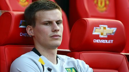 Ryan Bennett waits things out ahead of kick off for Norwich City's visit to Old Trafford. Picture by