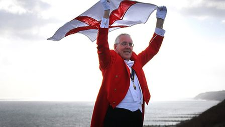 John Driscoll, Overstrand's flagmaster and member of the Royal Society of St George raises the flag