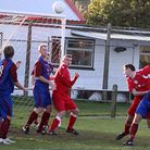 Action from the Budleigh Salterton 3-0 defeat to Stoke Gabriel. George Pannell heads towards the Sto
