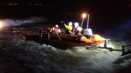 The Exmouth RNLI inshore lifeboat George Bearman is pictured last night (January 8), joining the sea