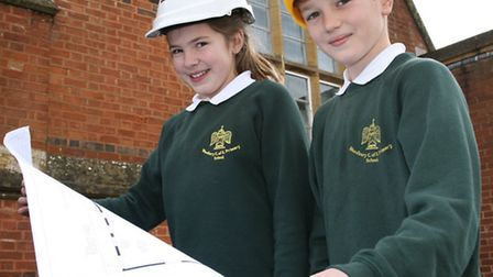 Planning for their education-Children from Woodbury C of E primary school look over propsals for the